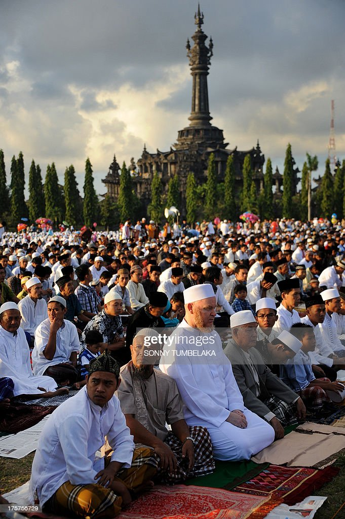 Indonesian Muslims take part in special morning prayers near the Bajrah Sandhi monument in Denpasar on Indonesia's island of Bali on August 8, 2013. Muslims around the world will celebrate Eid al-Fitr this week, marking the end of holiest month of Ramadan during which followers are required to abstain from food, drink and sex from dawn to dusk.