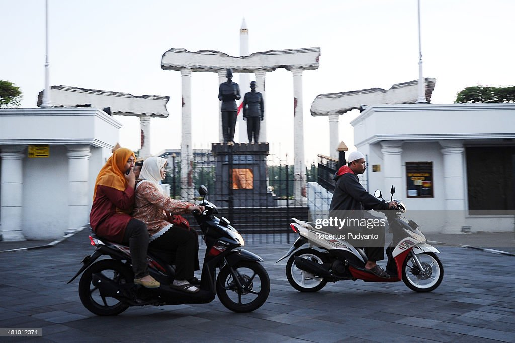 Indonesian Muslims walk to perform Eid prayer on July 17 2015 in Surabaya Indonesia Muslims worldwide observe the Eid AlFitr prayer to mark the end...