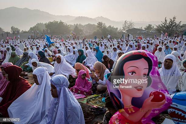 Indonesian muslims women attend Eid AlFitr prayer on 'sea of sands' at Parangkusumo beach on July 17 2015 in Yogyakarta Indonesia Eid AlFitr marks...