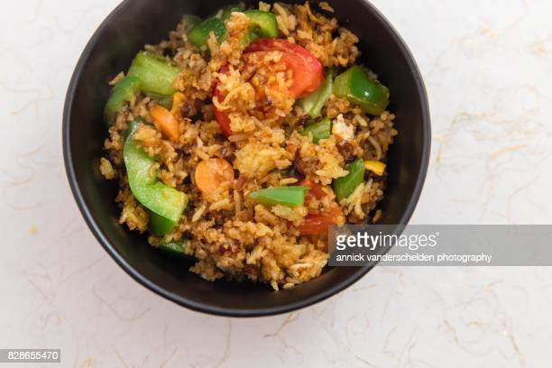Indonesian nasi goreng with bumbu in a black bowl.