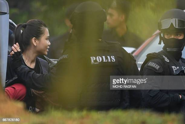 CORRECTION Indonesian national Siti Aisyah is escorted by Malaysian police for a court appearance with Vietnamese national Doan Thi Huong at the...