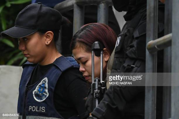 Indonesian national Siti Aisyah is escorted with a heavy police presence after a court appearance with Vietnamese national Doan Thi Huong at the...