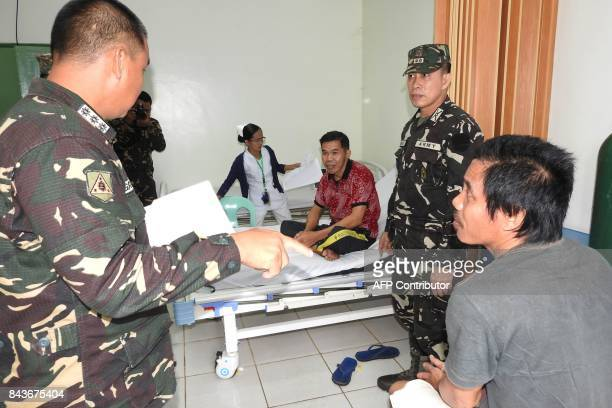 Indonesian nationals Sarapuddin Koni and Sawal Maryam who escaped after being kidnapped by the Abu Sayyaf group are interviewed by Philippine...