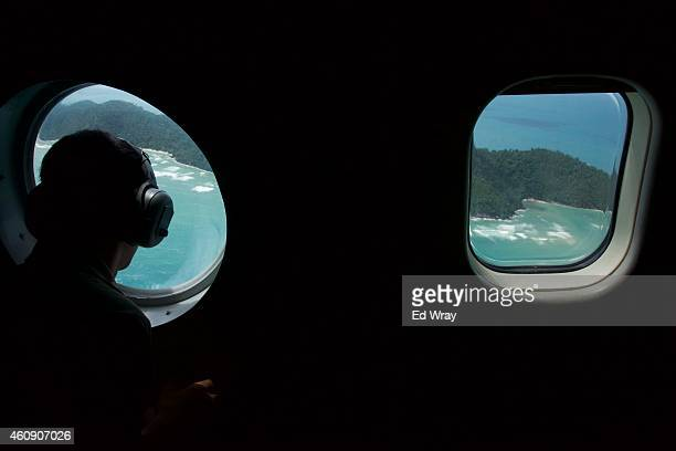 Indonesian Navy airmen search the waters near Bangka Island for debris from AirAsia Flight QZ8501 in a navy fixed wing patrol craft near Bangka...