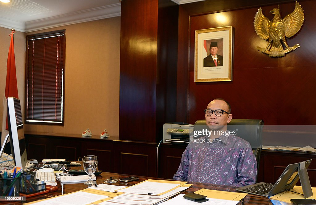 Indonesian newly appointed Finance Minister Chatib Basri, currently head of Indonesia's Investment Coordinating Board (BKPM), sits at his desk as he poses for a photograph in his office in Jakarta on May 20, 2013. President Susilo Bambang Yudhoyono on May 20 named Chatib Basri as the new finance minister, putting the country's investment chief in charge of Southeast Asia's top economy at a time of major challenges.