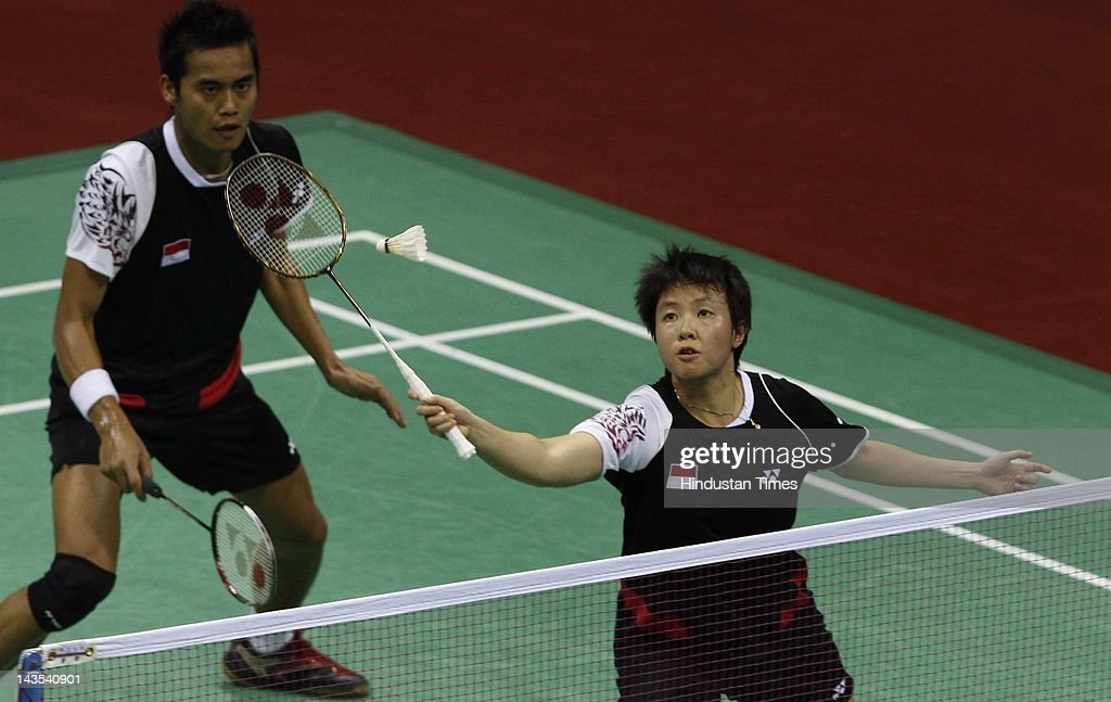 Indonesian pair of Tontowi Ahmad and <a gi-track='captionPersonalityLinkClicked' href=/galleries/search?phrase=Liliyana&family=editorial&specificpeople=4055313 ng-click='$event.stopPropagation()'>Liliyana</a> Natsir in action against the South Korean pair of Lee Yong-dae and Ha Jung-eun in mixed doubles semi final of India Open Super Series Badminton at Siri Fort Sports Complex on April 28, 2012 in New Delhi, India. The Indonesian pair got better of South Koreans in straight sets 21-7 and 21-14 to set the clash with Thai pair Sudket Prapakamol and Saralee Thoungthongkam in the finals.