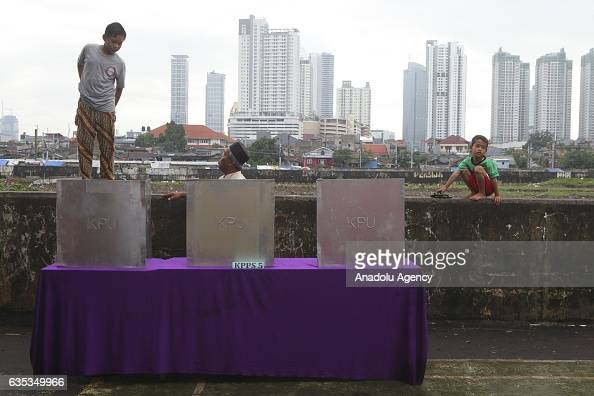 Indonesian people are seen during election day to elect Jakarta Governor to a fiveyear term in Jakarta Indonesia on February 15 2017 Incumbent...