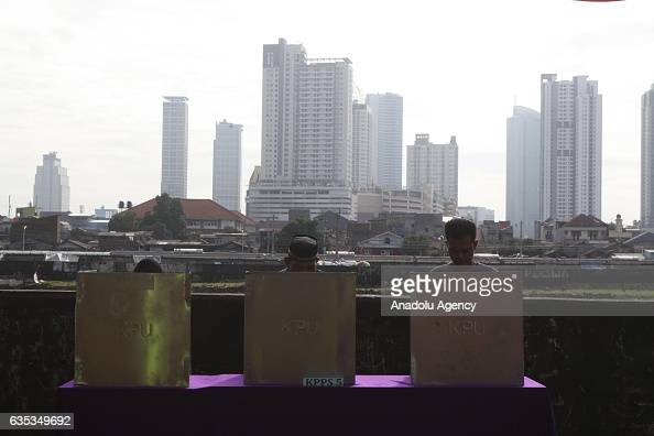 Indonesian people cast their ballots during election day to elect Jakarta Governor to a fiveyear term in Jakarta Indonesia on February 15 2017...