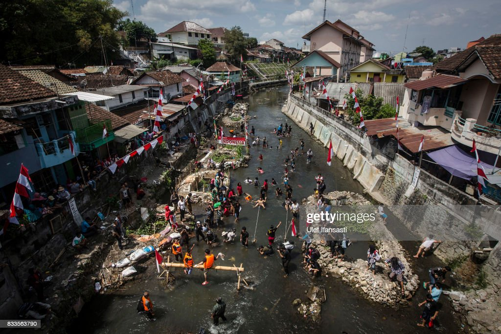 Indonesian people gather at Code river as they celebrations for the 72nd Indonesia National Independence dayon August 17, 2017 in Yogyakarta, Indonesia. Indonesia became an independent nation on 17th August 1945, having previously been under Dutch rule.