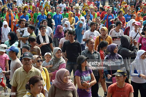 Indonesian people participate in 'Indonesia Menari' an Indonesian dance event in Jakarta on November 24 2013 The event is held to encourage people to...