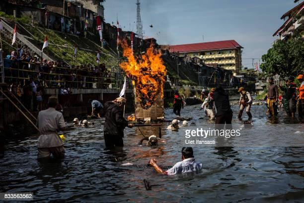Indonesian people perform a theatrical battle for independence during celebrations for the 72nd Indonesia National Independence day at Code river on...