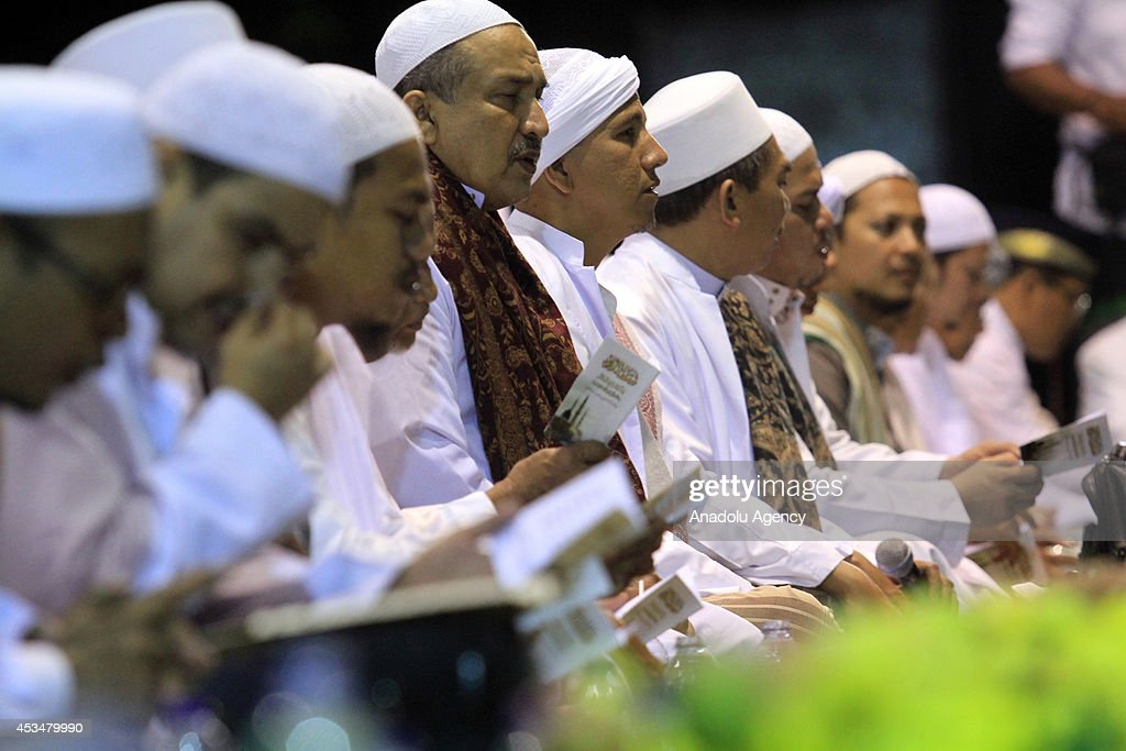 Indonesian people read the holy book Quran as more than 50,000 Indonesian Muslims gathered in Solo, to protest against the attacks of the Islamic state in Iraq and Syria (ISIS) , on August 10, 2014 in Solo, Central Java, Indonesia.
