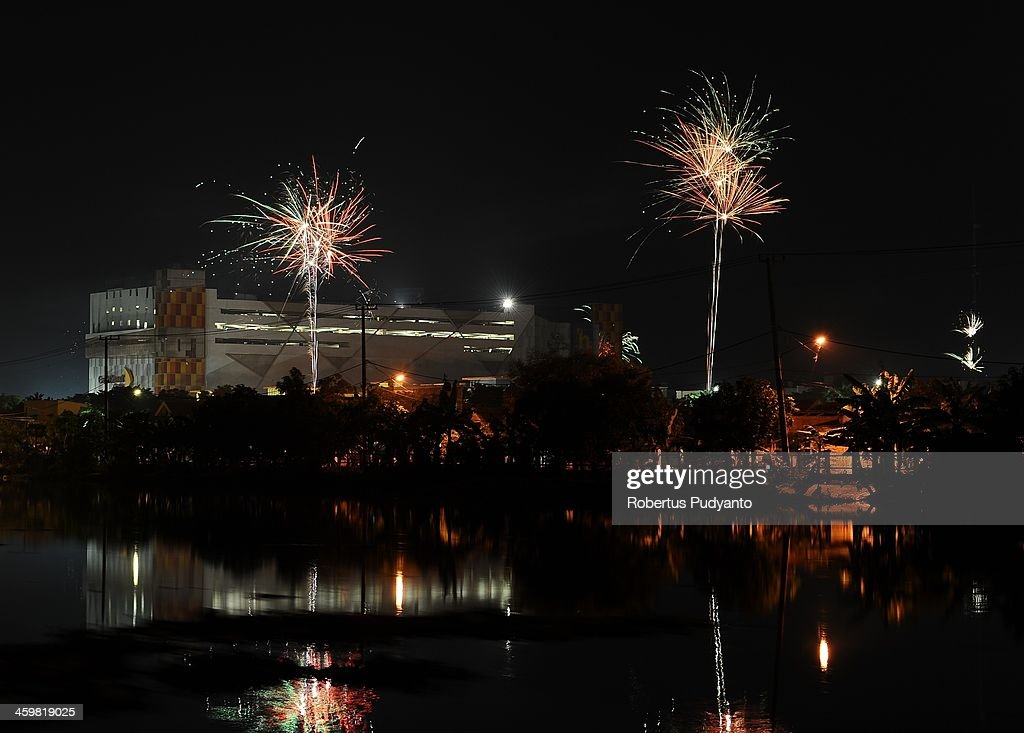 Indonesian people set up fireworks to celebrate 2014 New Years on December 31, 2013 in Surabaya, Indonesia. A wave of pyrotechnic displays kicked off New Years celebrations in major cities around the world.
