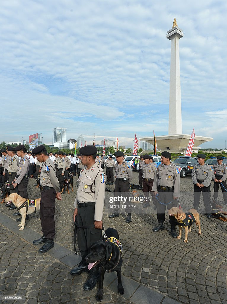 Indonesian police and their dogs attend a security roll call ahead of the Christmas and New Year Eve festivities in Jakarta on December 21, 2012. Indonesia's government will beef up its security by deploying around 82,000 policemen across the country to operate from December 23 to January 1. Indonesian was rocked by a series of coordinated bomb blasts at several churches and police stations nationwide on Christmas Eve in 2000.