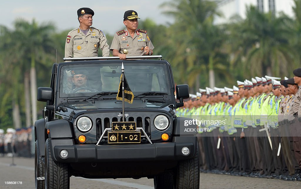 Indonesian police commissioner General Imam Sudjarwo (R-on jeep) reviews policemen during a security roll call ahead of the Christmas and New Year Eve festivities in Jakarta on December 21, 2012. Indonesia's government will beef up its security by deploying around 82,000 policemen across the country to operate from December 23 to January 1. Indonesian was rocked by a series of coordinated bomb blasts at several churches and police stations nationwide on Christmas Eve in 2000.