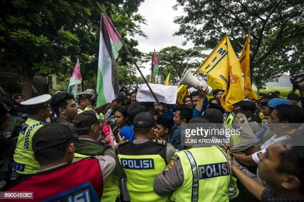 Indonesian police control demonstrators during a protest against US President Donald Trump's recognition of Jerusalem as the capital of Israel...