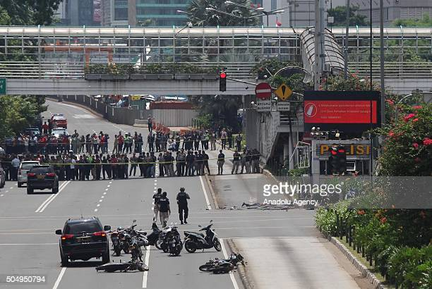 Indonesian police officers stand guard near the location of explosions after a series of blasts hit the Indonesia capital Jakarta on January 14 2016