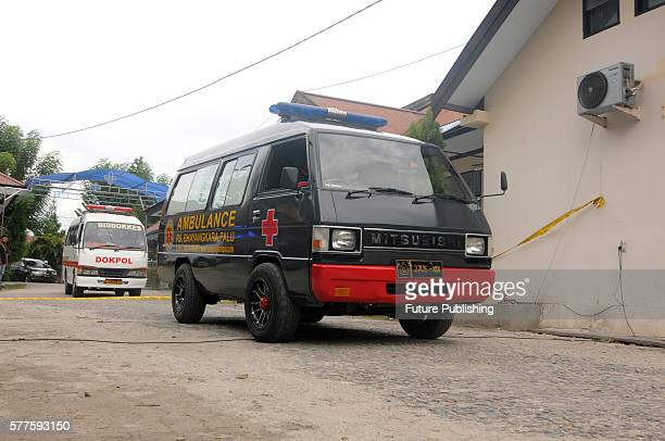 Indonesian police transfer a body bag from an ambulance at a local hospital on July 19 2016 in Palu Central Sulawesi province Indonesia Indonesia's...
