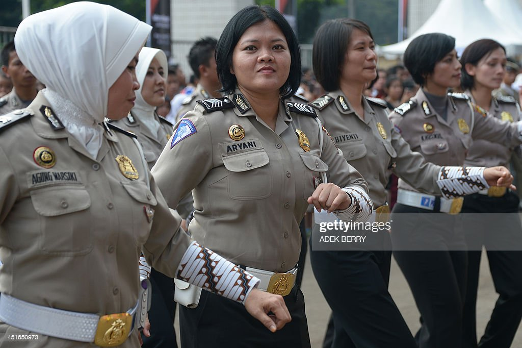 Indonesian police women participate in 'Indonesia Menari' an Indonesian dance event in Jakarta on November 24 2013 The event is held to encourage...