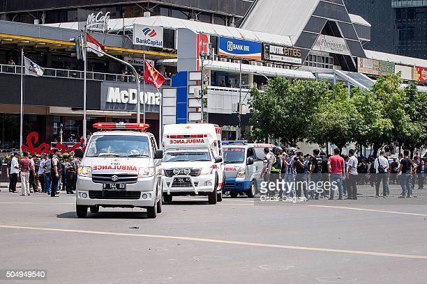 Indonesian policemen and ambulance arrive in front of Sarinah shopping mall after a series of blasts hit the Indonesia capital Jakarta on January 14...