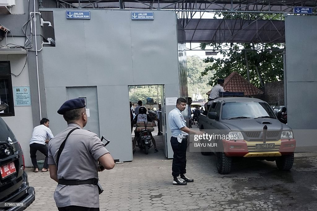 Indonesian policemen arrive to cross to Nusakambangan island at the Cilacap port the only gate to Indonesia's highest security Nusakambangan prison...