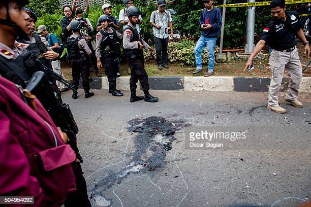 Indonesian policemen guard the blast site after a series of explosions hit the Indonesia capital on January 14 2016 in Jakarta Indonesia Reports of...