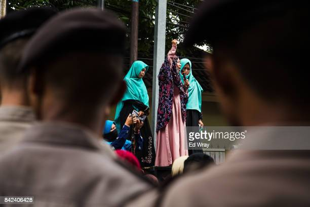 Indonesian policemen guard the Myanmar embassy as members of a group calling themselves friends of Muslim Rohingya listen to an account of atrocities...