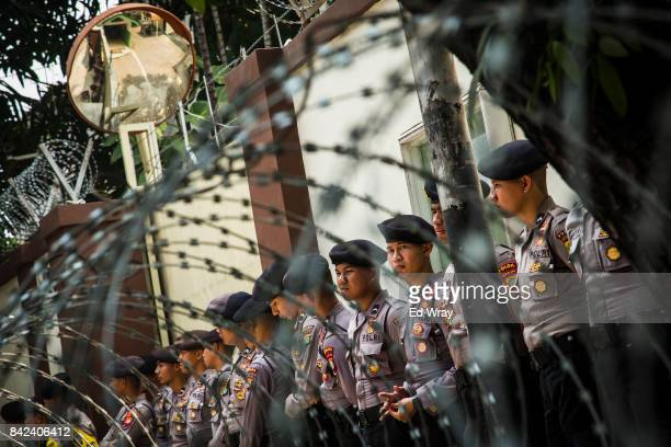 Indonesian policemen guard the Myanmar embassy during a rally by hundreds of member's of an all women's group called 'Friends of Muslim Rohingya's in...