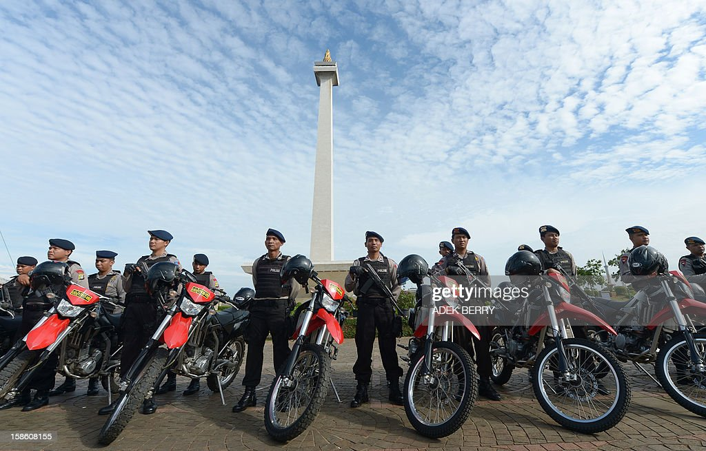 Indonesian policemen line up with their motorbikes as they attend a security roll call ahead of the Christmas and New Year Eve festivities in Jakarta on December 21, 2012. Indonesia's government will beef up its security by deploying around 82,000 policemen across the country to operate from December 23 to January 1. Indonesian was rocked by a series of coordinated bomb blasts at several churches and police stations nationwide on Christmas Eve in 2000.