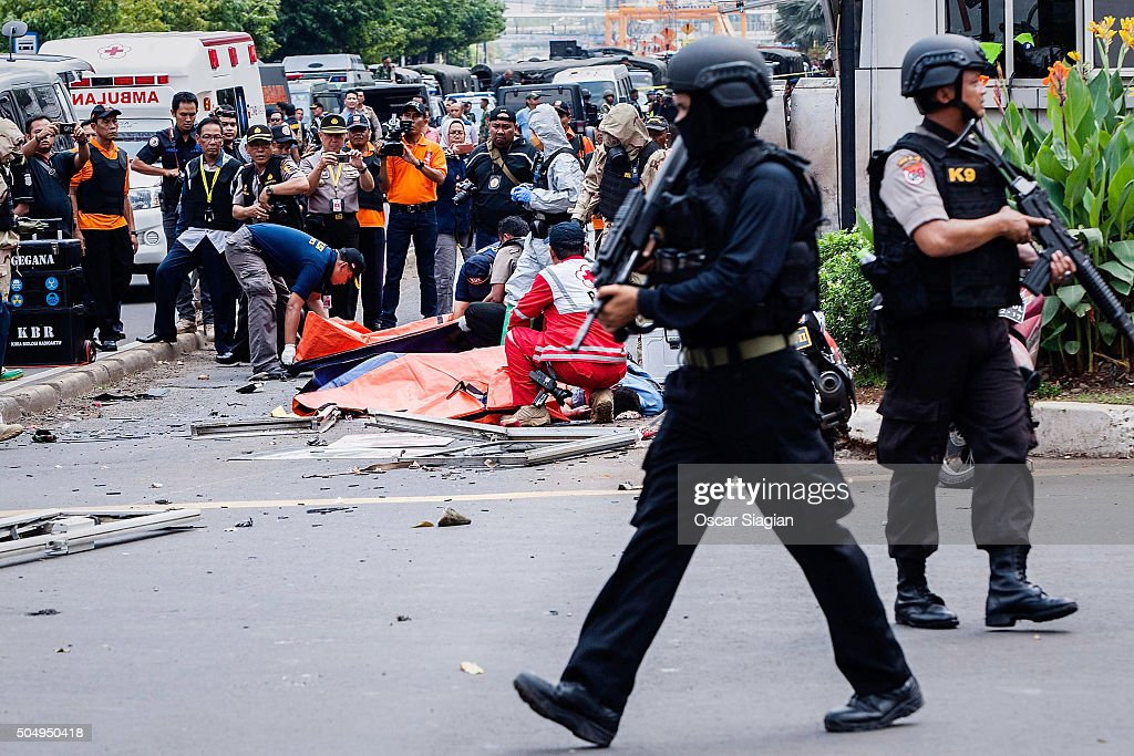 Indonesian policemen stand guard in front of Sarinah shopping mall after a series of blasts hit the Indonesia capital Jakarta on January 14 2016 in...
