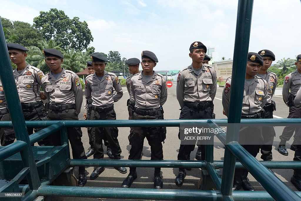 Indonesian policemen stand guard inside the parliament compound as religious leaders hold a protest against Indonesian government failures to guarantee freedom of religion in Jakarta on April 8, 2013. Around 200 Indonesian minority leaders protested against religious intolerance and discrimination in the Muslim-majority country. The group representing Christians, Ahmadiyah and Shiite Islamic minority sects gathered outside the parliament, singing the country's national anthem and shouting 'We have rights' and 'Stop intolerance'.