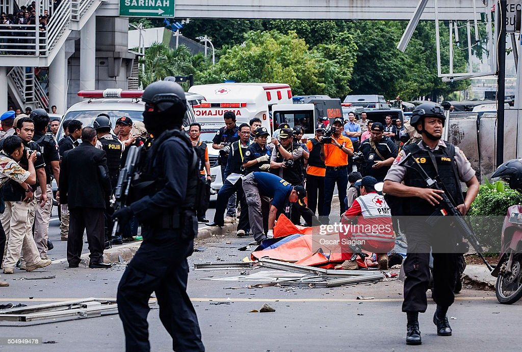Indonesian policemen stands guard near the blast site after a series of explosions hit the Indonesia capital on January 14 2016 in Jakarta Indonesia...