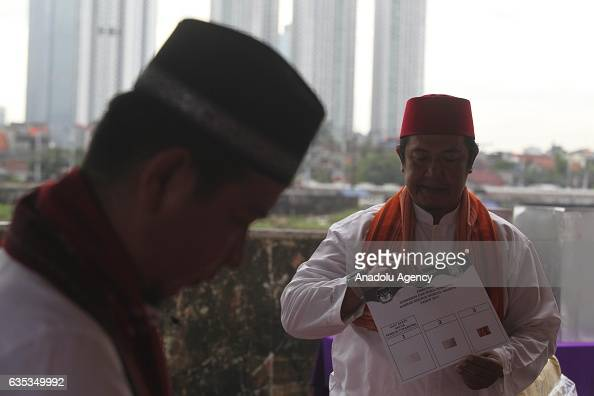 Indonesian poll officer prepares ballots during election day to elect Jakarta Governor to a fiveyear term in Jakarta Indonesia on February 15 2017...