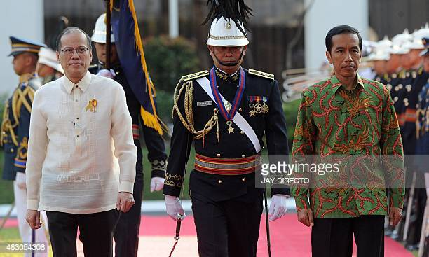 Indonesian President Joko Widodo and Philippine President Benigno Aquino inspect an honour guard during a welcoming ceremony at the presidential...