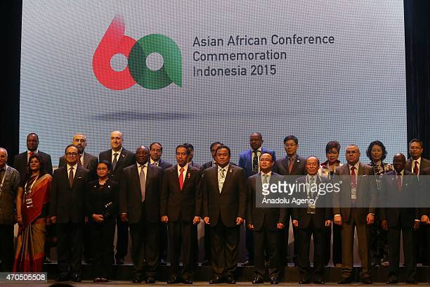 Indonesian President Joko Widodo Deputy President of South Africa Cyril Ramaphosa together with Asian and African business leaders pose for a photo...