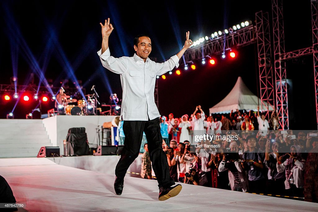 Indonesian President <a gi-track='captionPersonalityLinkClicked' href=/galleries/search?phrase=Joko+Widodo&family=editorial&specificpeople=6657368 ng-click='$event.stopPropagation()'>Joko Widodo</a> gestures during the people celebration know as 'Pesta Rakyat' at National Museum on October 20, 2014 in Jakarta, Indonesia. <a gi-track='captionPersonalityLinkClicked' href=/galleries/search?phrase=Joko+Widodo&family=editorial&specificpeople=6657368 ng-click='$event.stopPropagation()'>Joko Widodo</a> was sworn in October 20, as the president of Indonesia with an inauguration ceremony held in Jakarta. Widodo was the eventual winner of a tightly fought and sometimes controversial election race against opposition candidate Prabowo Subianto. A number of key world leaders were in attendance including Australia's prime minister Tony Abbott.
