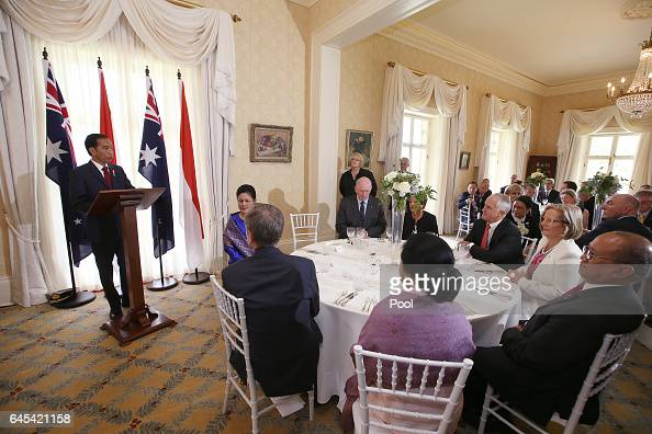 Indonesian President Joko Widodo left makes a speech at a state lunch attended by his wife Iriana second left Australian GovernorGeneral Sir Peter...