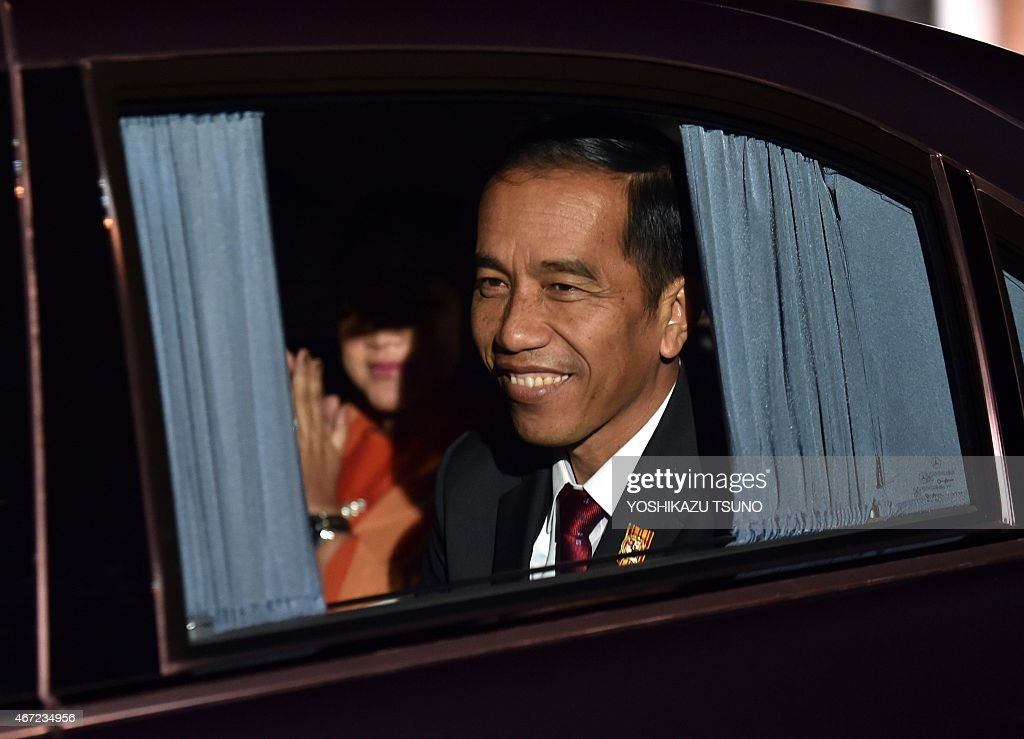 Indonesian President <a gi-track='captionPersonalityLinkClicked' href=/galleries/search?phrase=Joko+Widodo&family=editorial&specificpeople=6657368 ng-click='$event.stopPropagation()'>Joko Widodo</a> smiles next to his wife Iriana after arriving at Tokyo International Airport on March 22, 2015. Widodo is on a four-day visit to Japan. AFP PHOTO / Yoshikazu TSUNO
