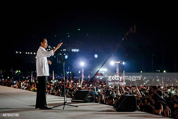 Indonesian President Joko Widodo speaks during the people celebration know as 'Pesta Rakyat' at National Museum on October 20 2014 in Jakarta...