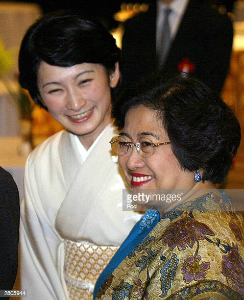 Indonesian President Megawati Sukarnoputri smiles while chatting with Japan's Princess Akishino during a memorial reception after ending the twoday...