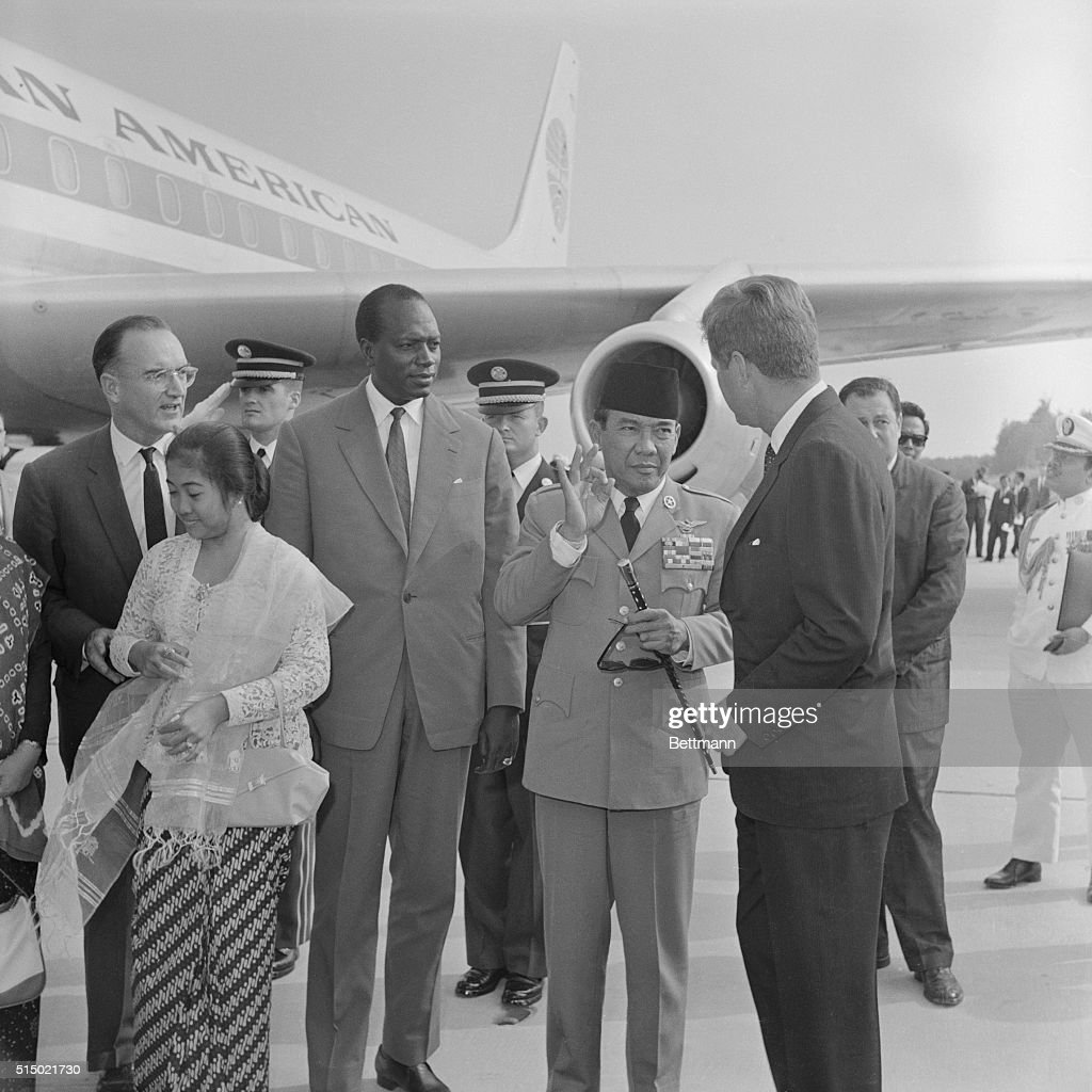 Indonesian President <a gi-track='captionPersonalityLinkClicked' href=/galleries/search?phrase=Sukarno&family=editorial&specificpeople=209275 ng-click='$event.stopPropagation()'>Sukarno</a> gives the 'OK' sign to President John Kennedy. At left is Mali's President Mobido. The two emissaries from the Belgrade conference have arrived to discuss averting World War III.