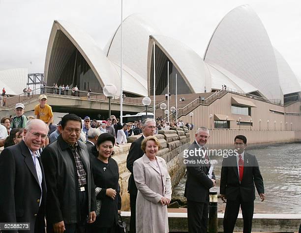 Indonesian President Susilo Bambang Yudhoyono and Australian Prime Minister John Howard walk past the Sydney Opera House before taking a harbour...