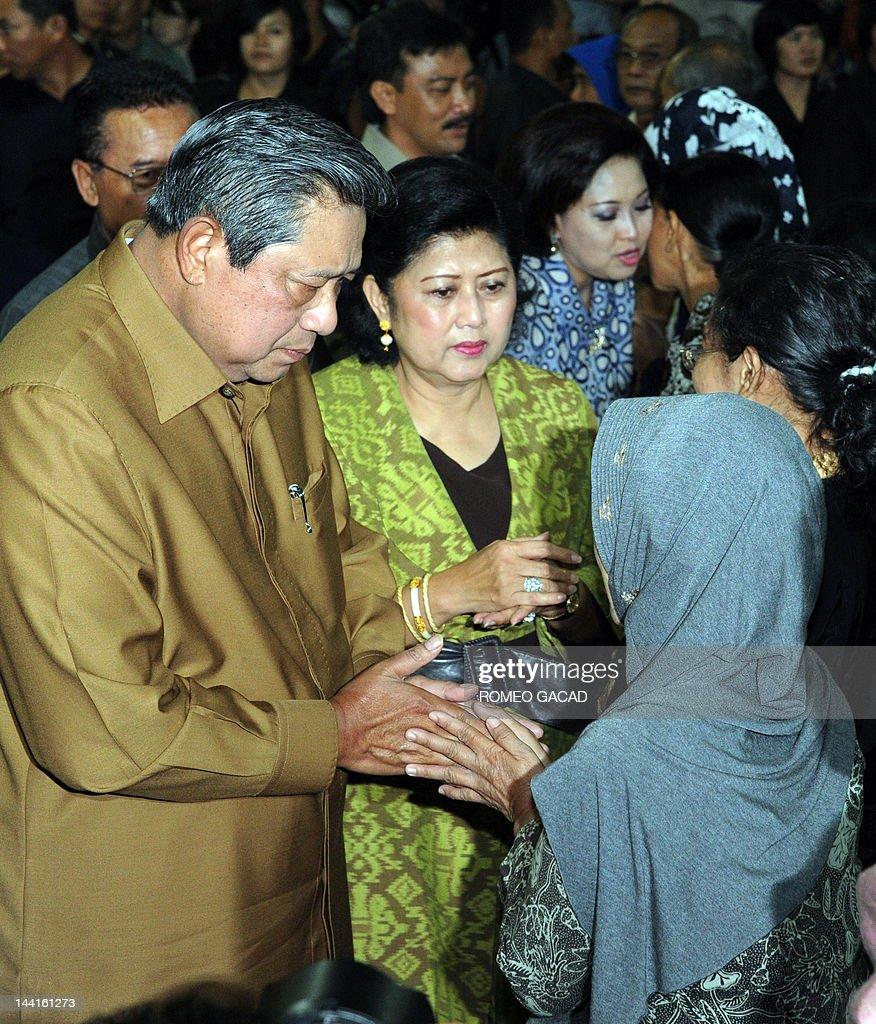 Indonesian President Susilo Bambang Yudhoyono and First Lady Ani Yudhoyono greet relatives of missing passengers of the illfated Russian Sukhoi...
