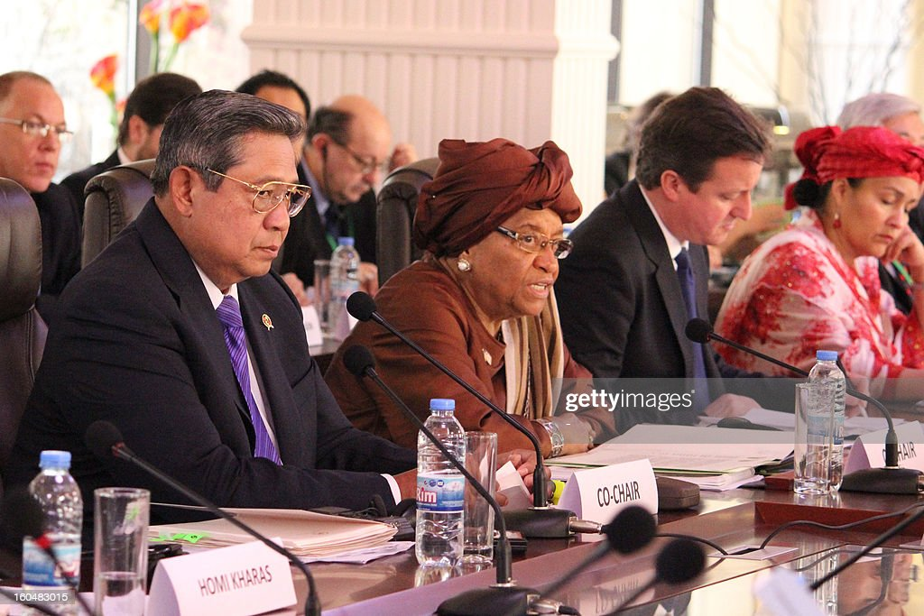 Indonesian President Susilo Bambang Yudhoyono, Liberian president Ellen Johnson Sirleaf and British Prime Minister David Cameron co-chair a high-level United Nations meeting on tackling global poverty in Monrovia on February 1, 2013. Cameron, who arrived in Monrovia late yesterday, toured the capital of the west African nation which is one of the world's most impoverished countries as it slowly rebuilds from a devastating civil war which ended a decade ago.