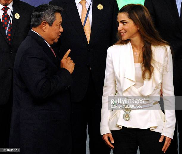 Indonesian President Susilo Bambang Yudhoyono speaks with Queen Rania of Jordan before a group photo during a conference in Nusa Dua on Bali island...