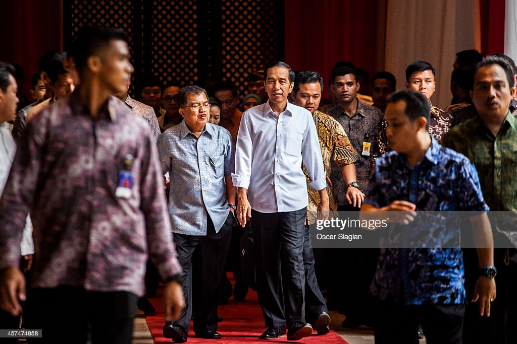 Indonesian President-elect <a gi-track='captionPersonalityLinkClicked' href=/galleries/search?phrase=Joko+Widodo&family=editorial&specificpeople=6657368 ng-click='$event.stopPropagation()'>Joko Widodo</a> (R) talk with Vice President-elect <a gi-track='captionPersonalityLinkClicked' href=/galleries/search?phrase=Jusuf+Kalla&family=editorial&specificpeople=667420 ng-click='$event.stopPropagation()'>Jusuf Kalla</a> (L) after inauguration rehearsal on October 19, 2014 in Jakarta, Indonesia. <a gi-track='captionPersonalityLinkClicked' href=/galleries/search?phrase=Joko+Widodo&family=editorial&specificpeople=6657368 ng-click='$event.stopPropagation()'>Joko Widodo</a> will be inaugurated as Indonesia's seventh president, Widodo was declared the winner of the presidential election with 53 percent of the vote over his rival Prabowo Subianto,