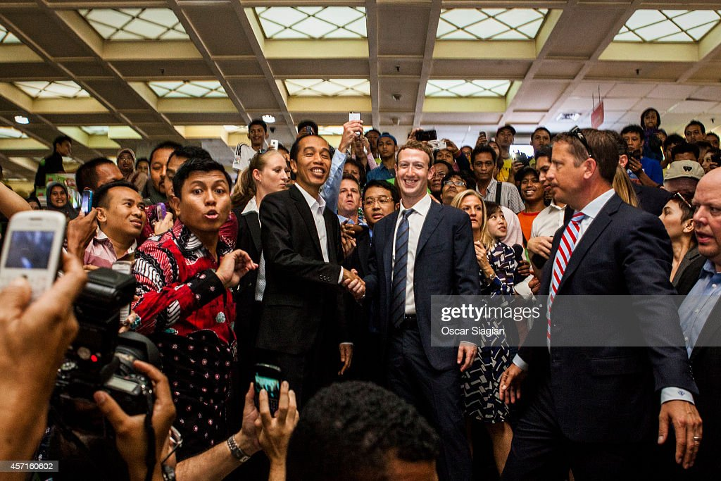 Indonesian President-elect Joko Widodo (L) with Facebook founder Mark Zuckerberg (R) shake hands at Tanah Abang Market the biggest textile market in South East Asia after meeting on October 13, 2014 in Jakarta, Indonesia. Mark Zukerberg is visiting Indonesia to attend Internet developers summit and meet heads of goverment. Indonesia is a country that has a population of 240 million and has approximately 60 million active users of social media