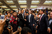 Indonesian Presidentelect Joko Widodo with Facebook founder Mark Zuckerberg shake hands at Tanah Abang Market the biggest textile market in South...