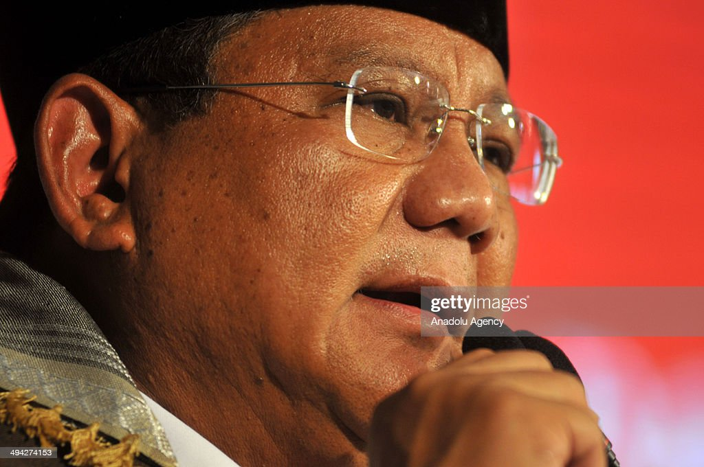Indonesian presidential candidate and former Lieutenant General Prabowo Subianto speaks to his supporters during a election meeting in Solo Central...
