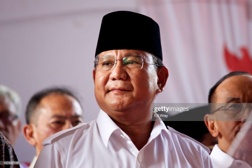 Indonesian Presidential Candidate and Retired General <a gi-track='captionPersonalityLinkClicked' href=/galleries/search?phrase=Prabowo+Subianto&family=editorial&specificpeople=3051840 ng-click='$event.stopPropagation()'>Prabowo Subianto</a> sits with members of his political coalition before addressing his supporters and the media on July 22, 2014 in Jakarta, Indonesia. Making allegations of widespread fraud in the electoral process, Prabowo said that he was withdrawing from the electoral process.